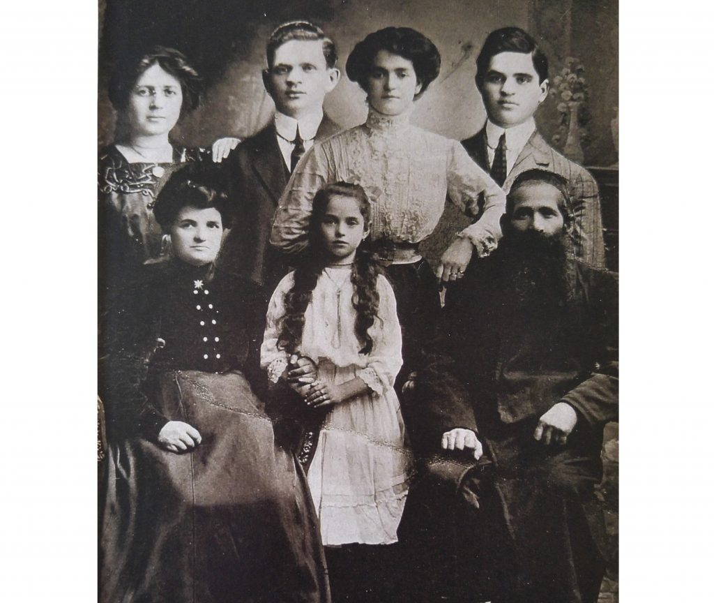 Moshe Ze'ev & his wife Chaya Tzipora Ziffer are seated, Genia Ziffer Rosenbaum, Henry's wife, is standing second from right.